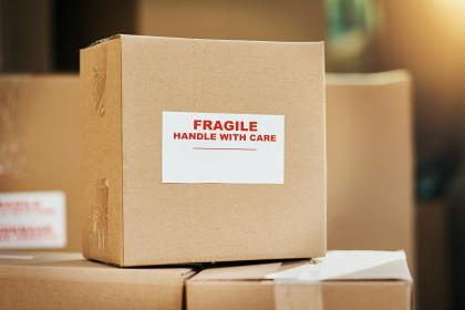 Packed moving boxes labelled 'Fragile, Handle with Care'