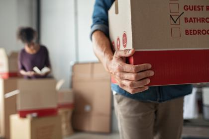 Couple packing boxes on Moving Day